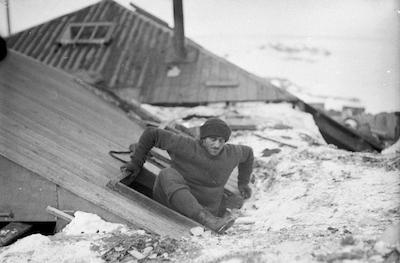 Hurley-Mertz leaving hut by trapdoor